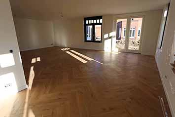 Vloerenhal Montfoort houten vloer voorbeeld in woonkamer